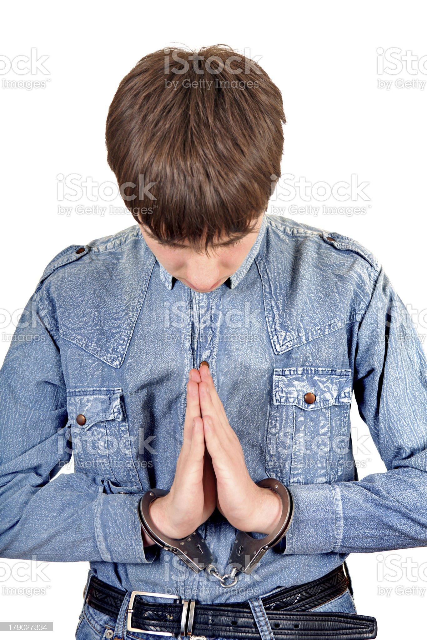 Praying Man in Handcuffs royalty-free stock photo