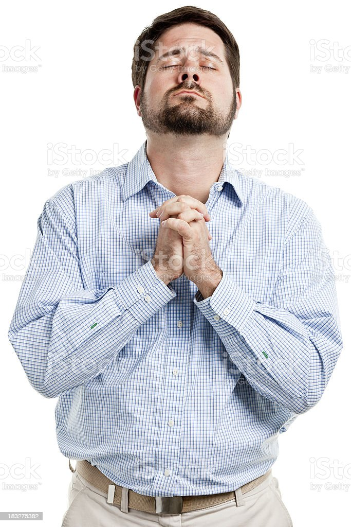 Praying Man With Hands Clasped And Eyes Closed royalty-free stock photo