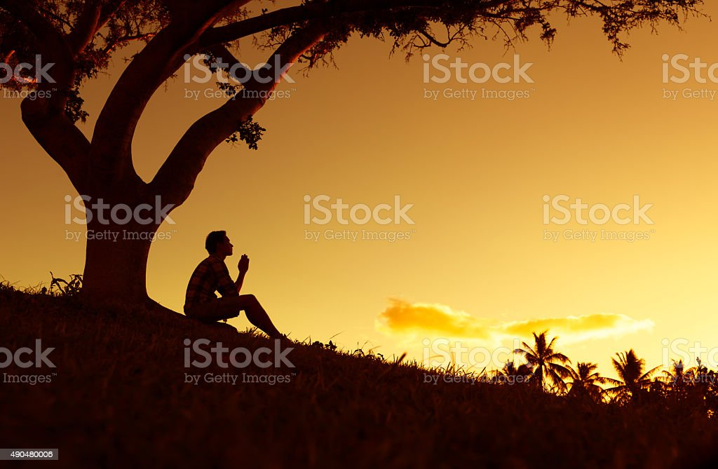 Praying men stock photo