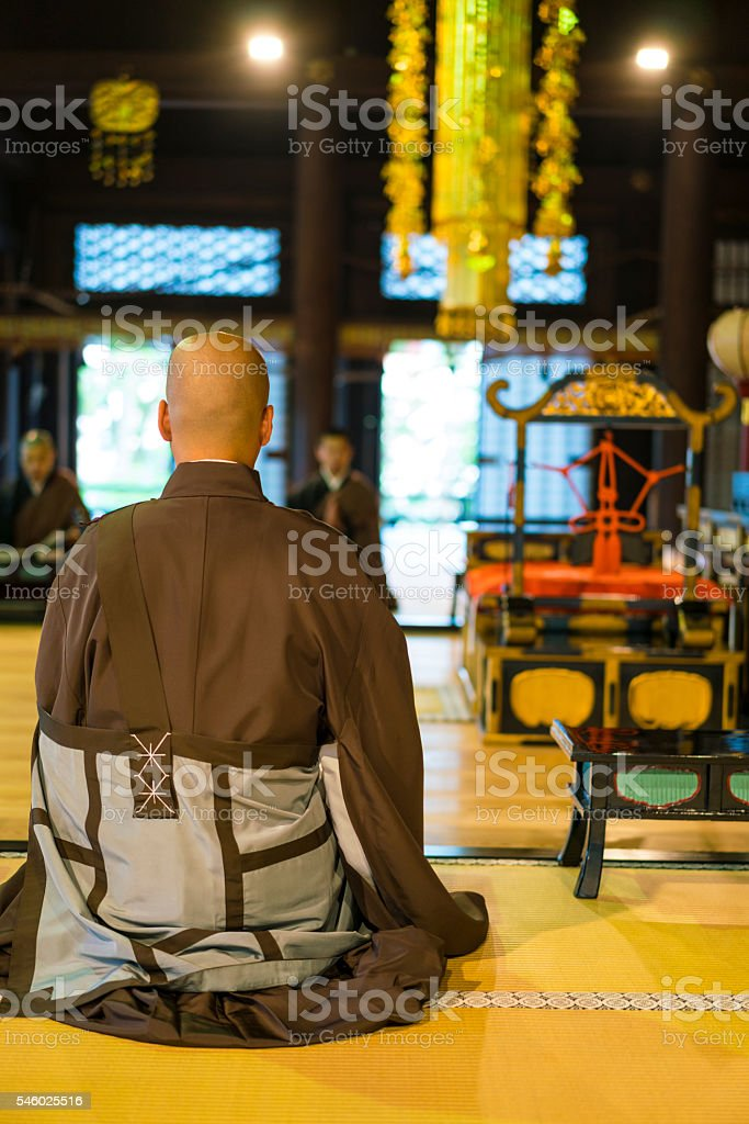 Praying Monks at Chion-ji temple in Kyoto, Japan stock photo