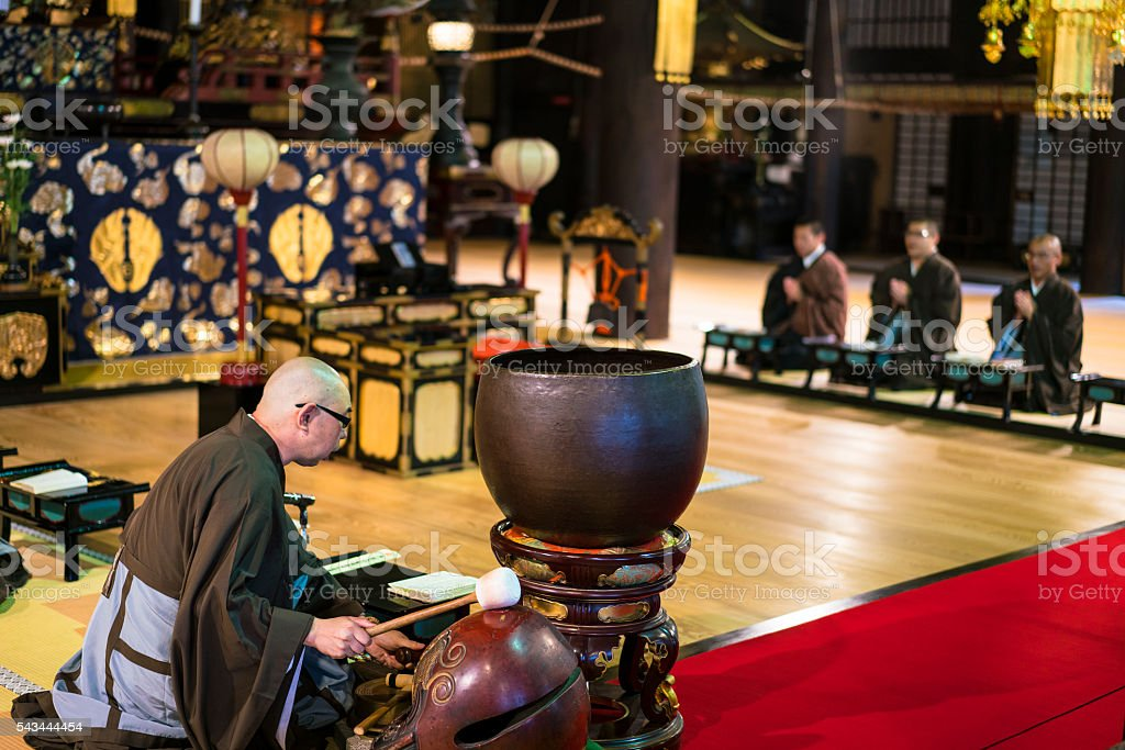 Praying Monks, with Iron Gong at Chion-ji temple, Kyoto, Japan stock photo