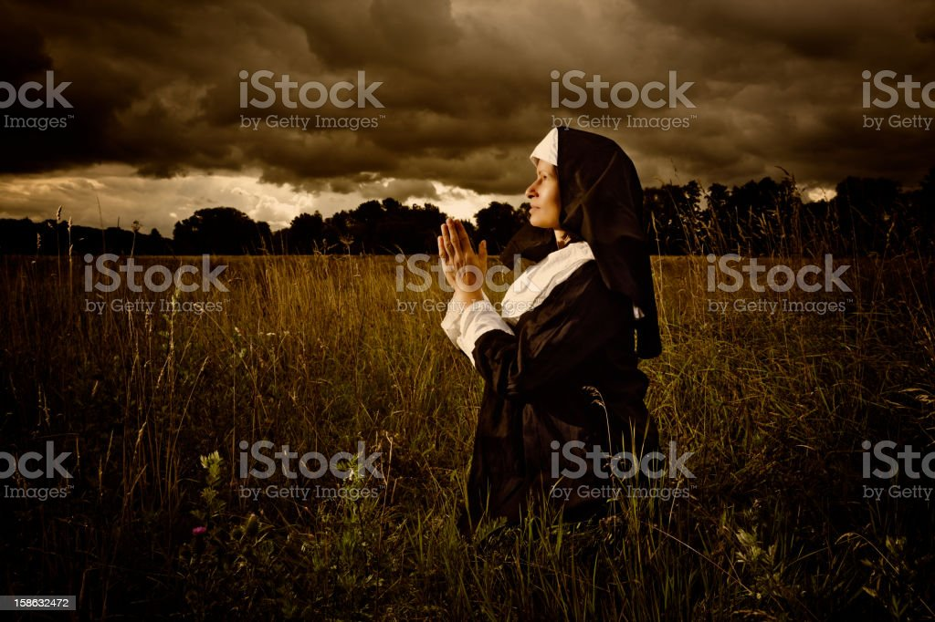 Praying Nun In The Evening stock photo