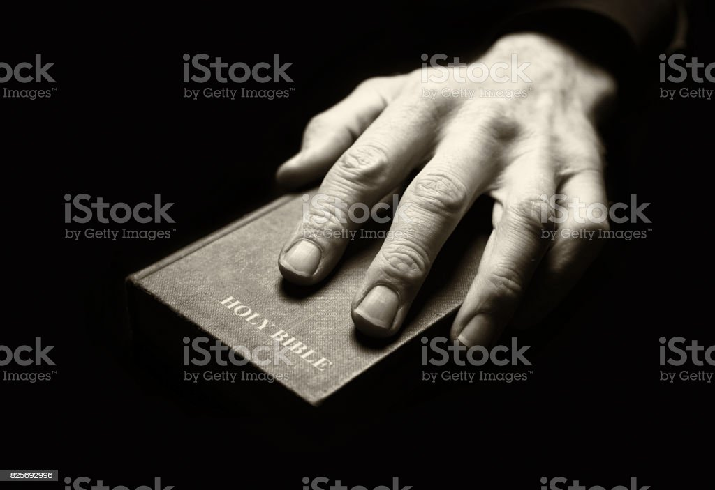 Praying on the Bible stock photo