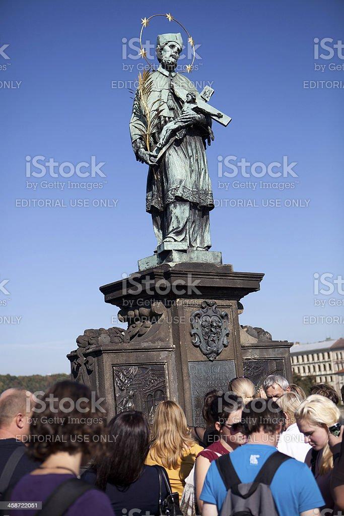 Praying on the Charles Bridge, Prague stock photo