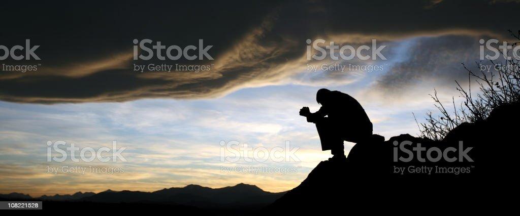 Praying on the Mountain royalty-free stock photo
