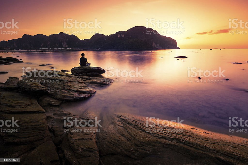 Praying on the rock stock photo