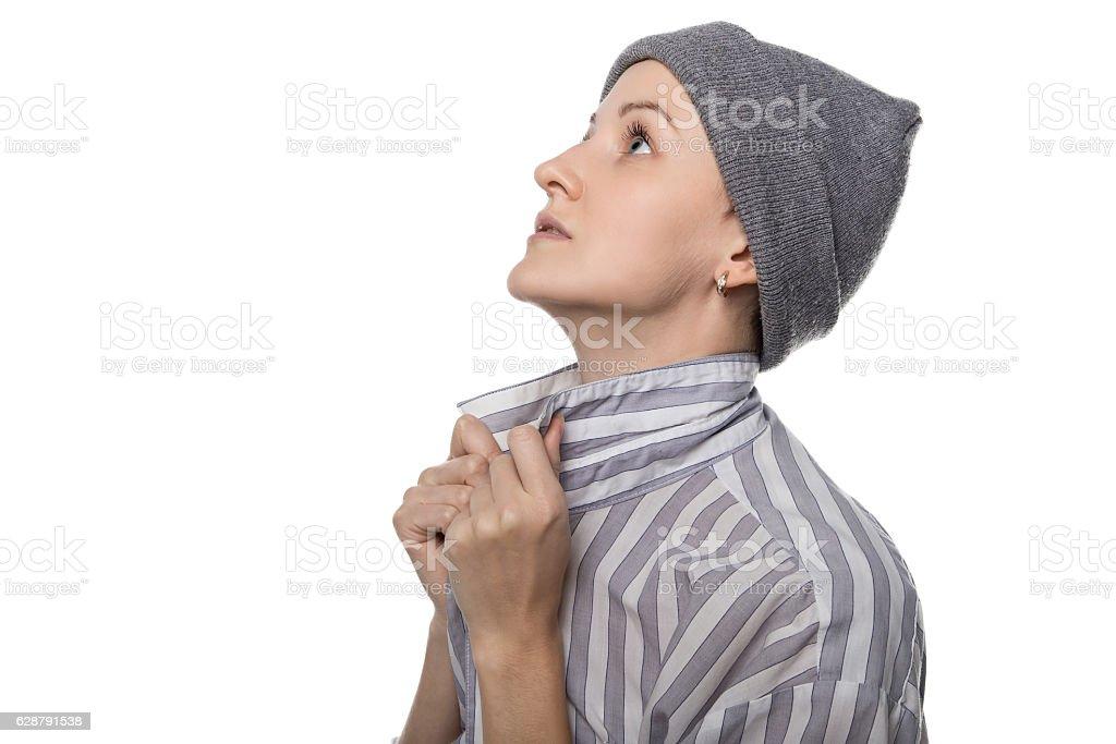 Praying pauper with headdress stock photo