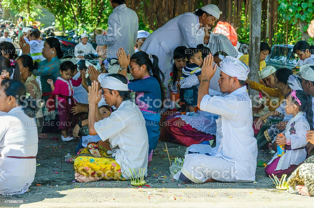 Praying people at a hindu temple in Bali - Indonesia stock photo