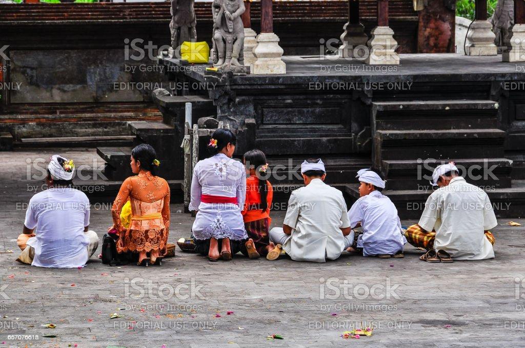 Praying people in Pura Besakih Temple in Bali, Indonesia stock photo