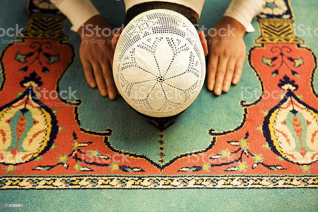 Praying people sajdah stock photo