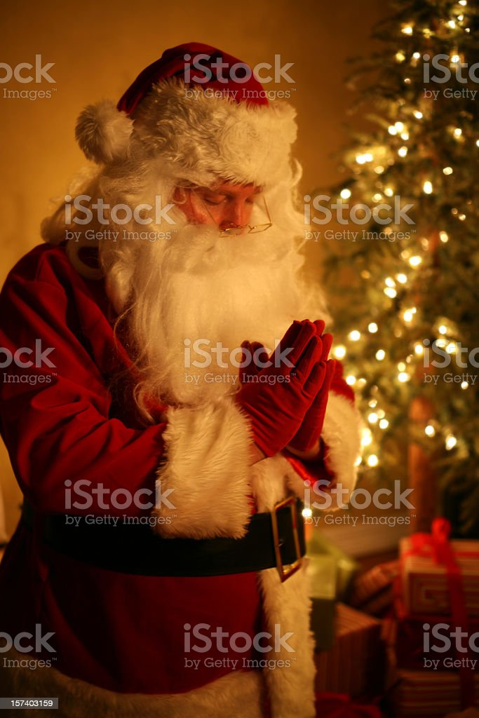 Praying Santa Kneeling On Christmas Eve royalty-free stock photo