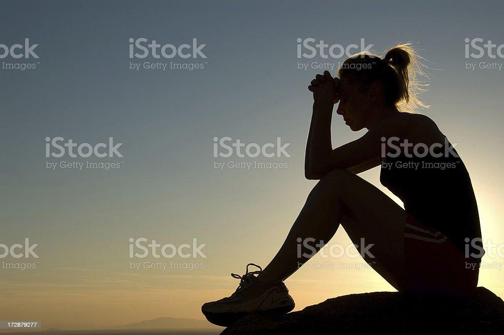 Praying Silhouette stock photo