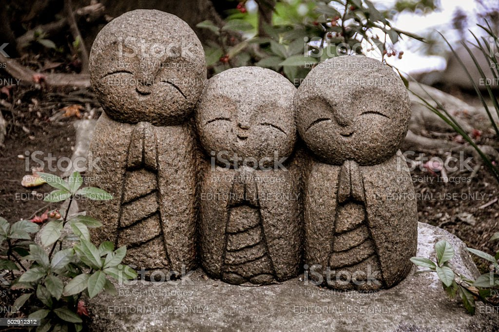 Praying statue - Hasedera Temple in Kamaura, Japan stock photo