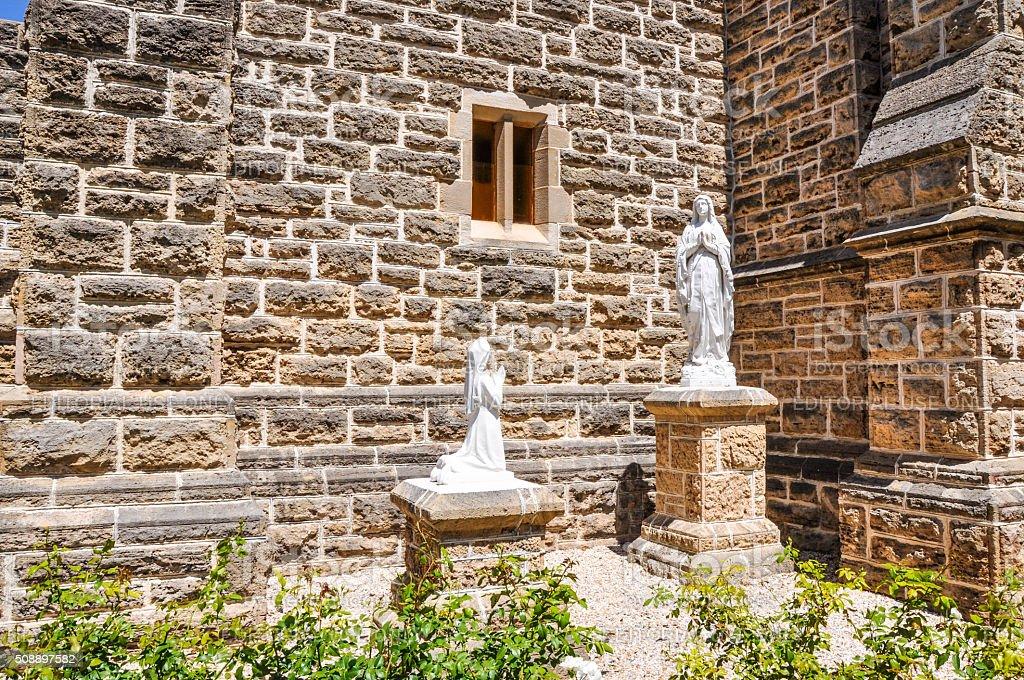 Praying Statues: St. Patrick's Basilica stock photo