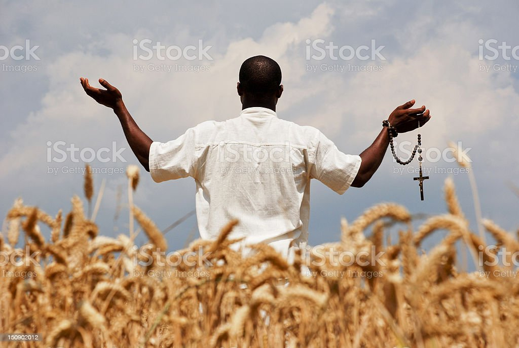 Praying to God for good harvest royalty-free stock photo
