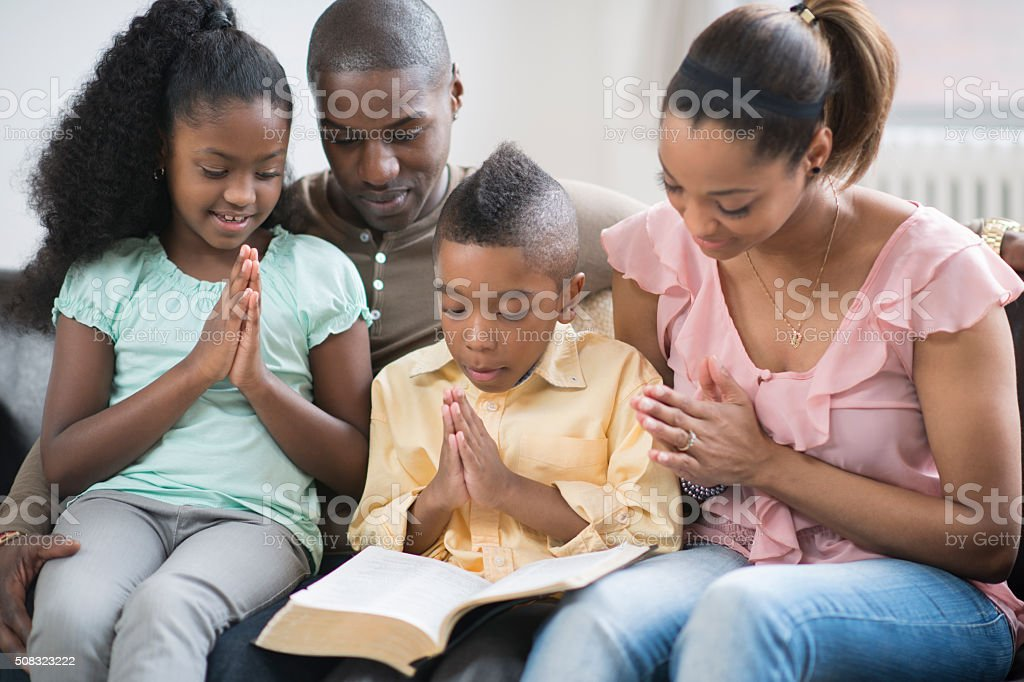 Praying Together as a Family stock photo