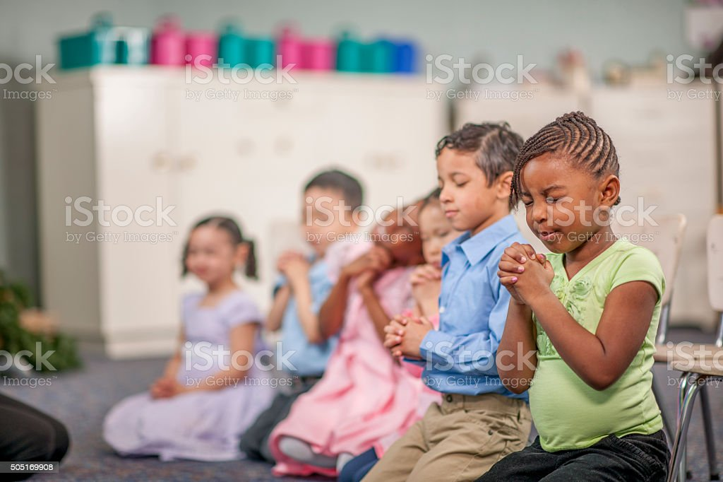 Praying Together in Class stock photo