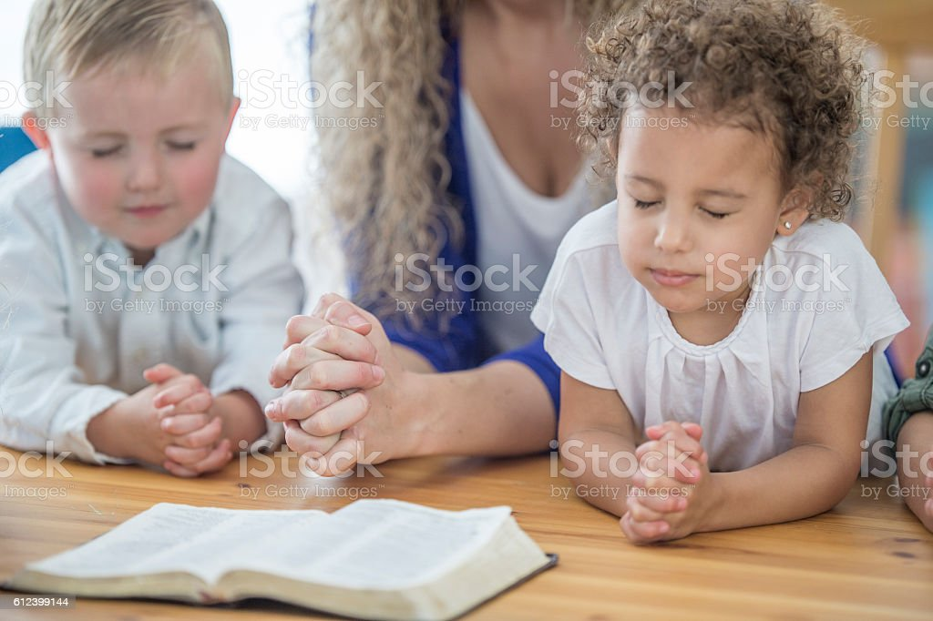 Praying Together in Sunday School stock photo
