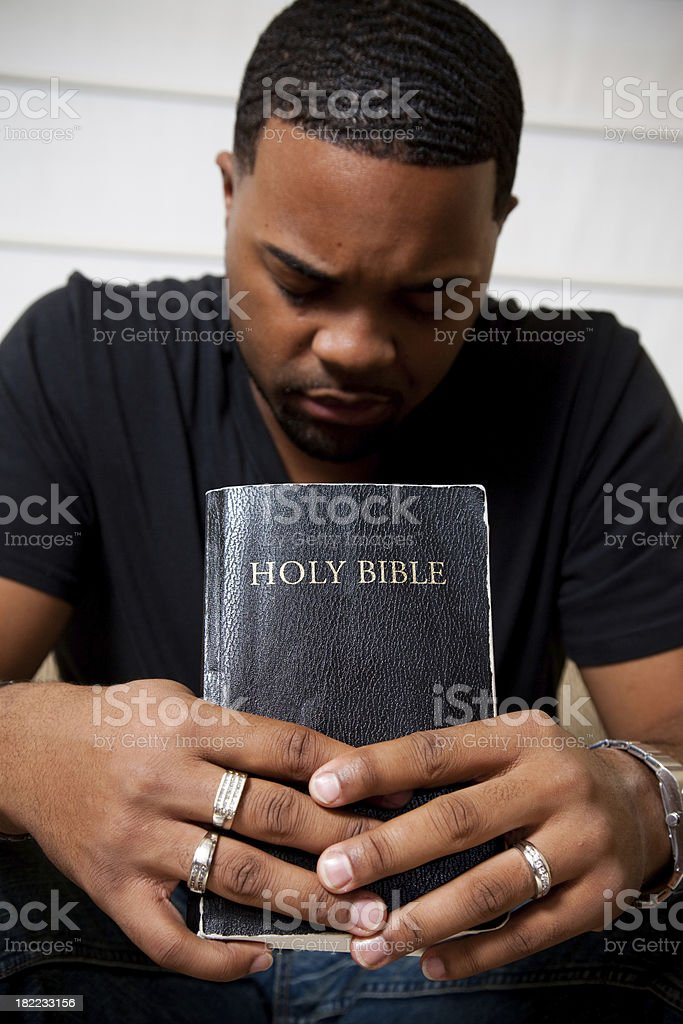 Praying while holding the Bible royalty-free stock photo