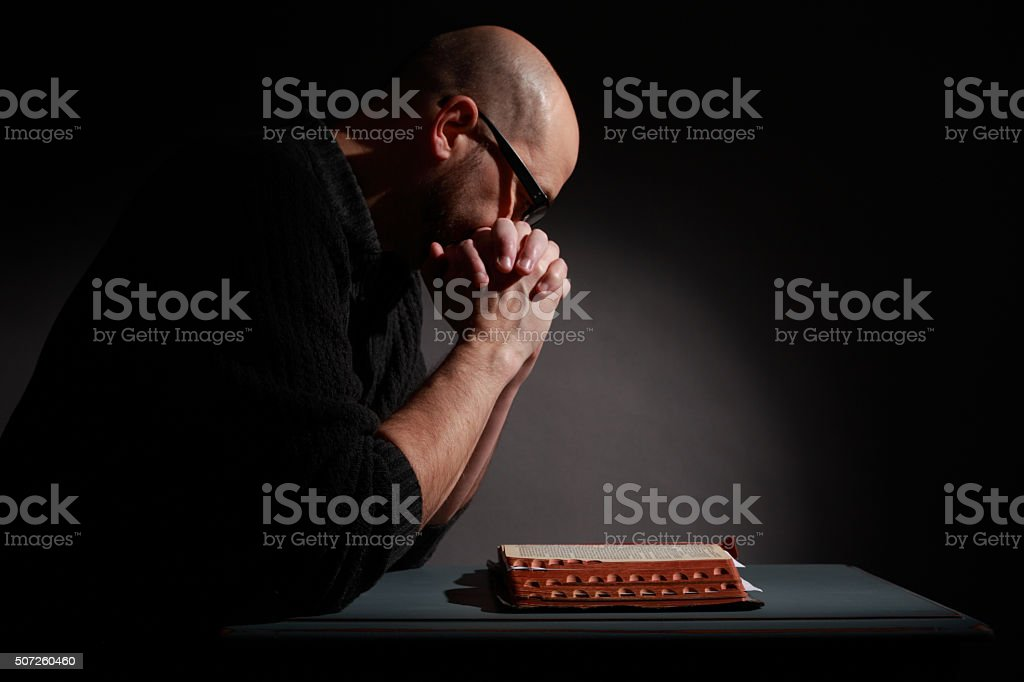 Praying While Studying the Bible stock photo