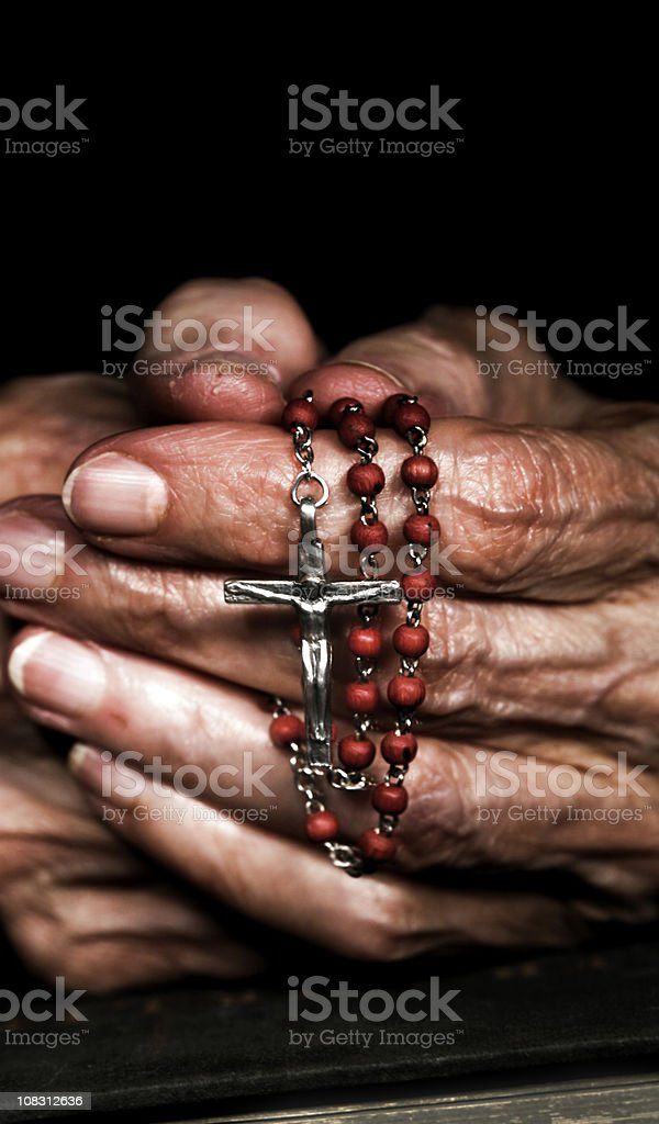 Praying with Rosary Beads royalty-free stock photo