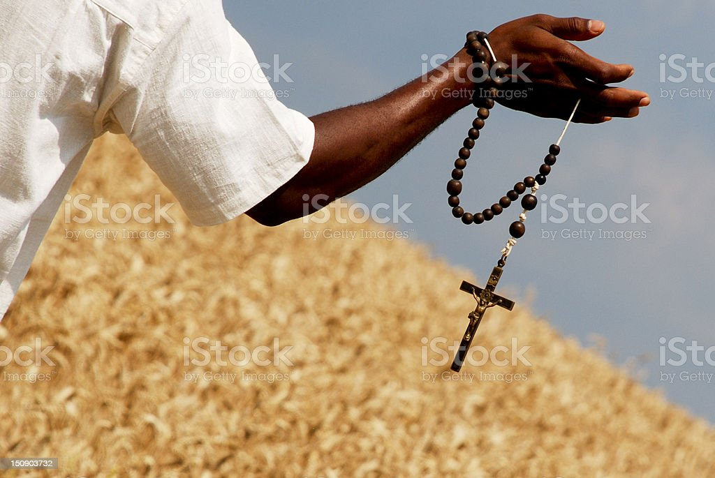 Praying with rosary for good harvest royalty-free stock photo