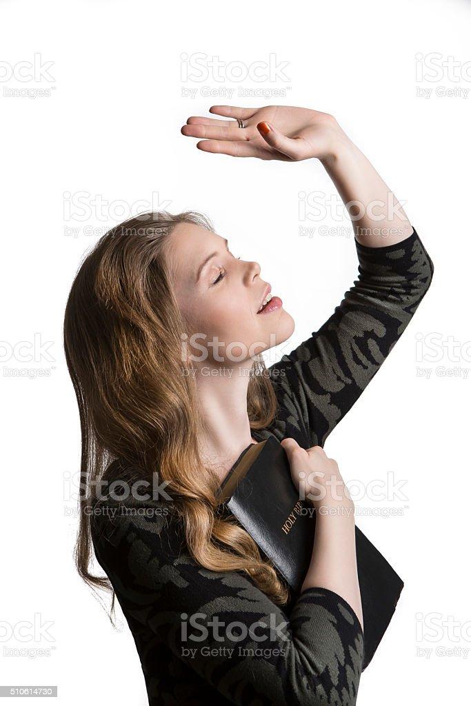 praying woman stock photo