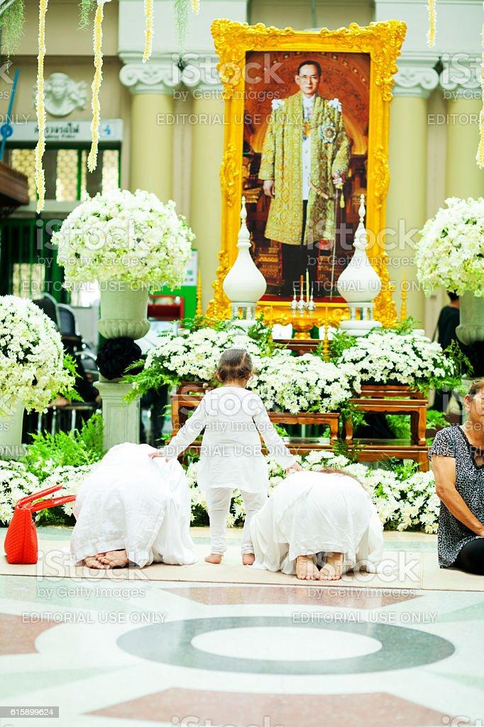 Praying women and small thai girl stock photo