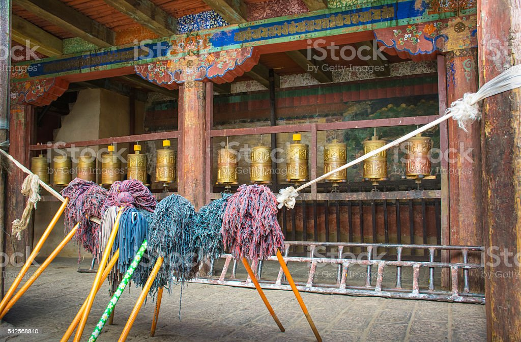 Prays and works courtyard of a monastery in Tibet stock photo