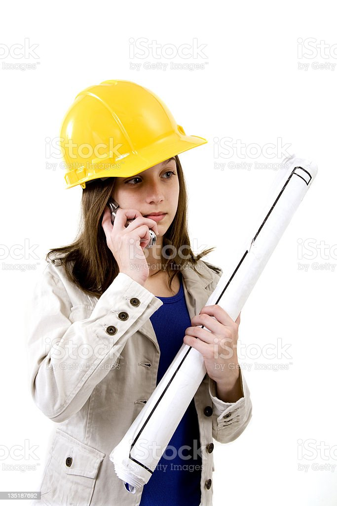 Pre teen dressed as an architect with hard hat, royalty-free stock photo