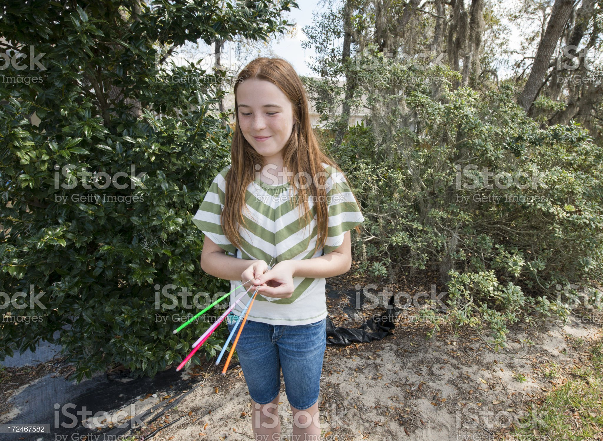 Pre Teen Girl Plays with Sparklers royalty-free stock photo