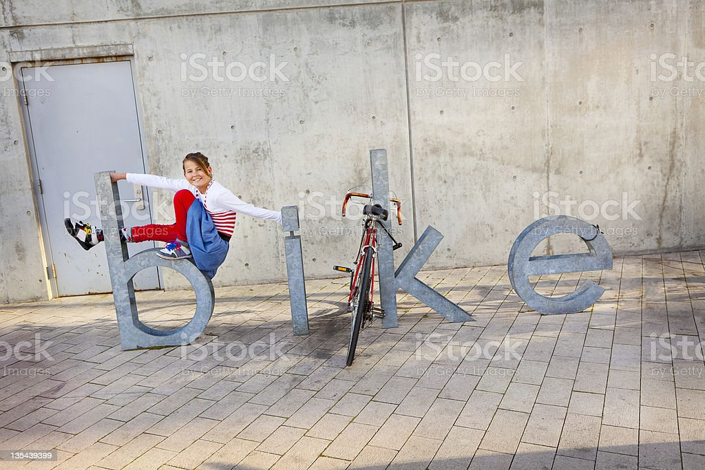 Pre Teen Sitting on Large Words 'BIKE' royalty-free stock photo