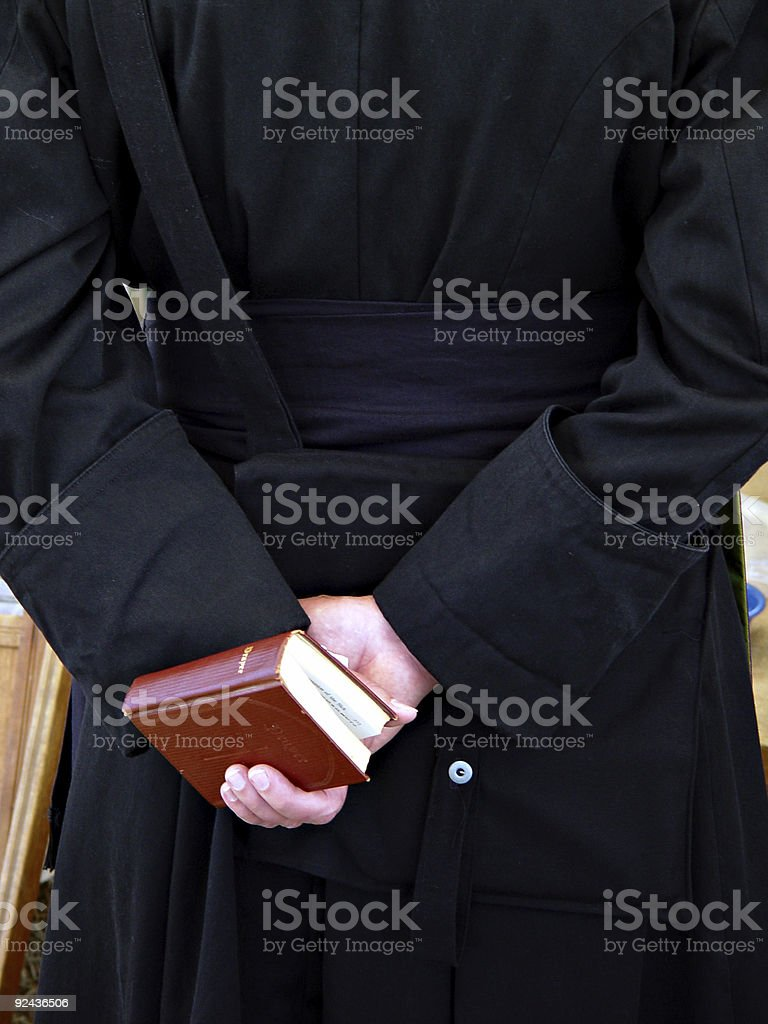 Preacher and Bible stock photo