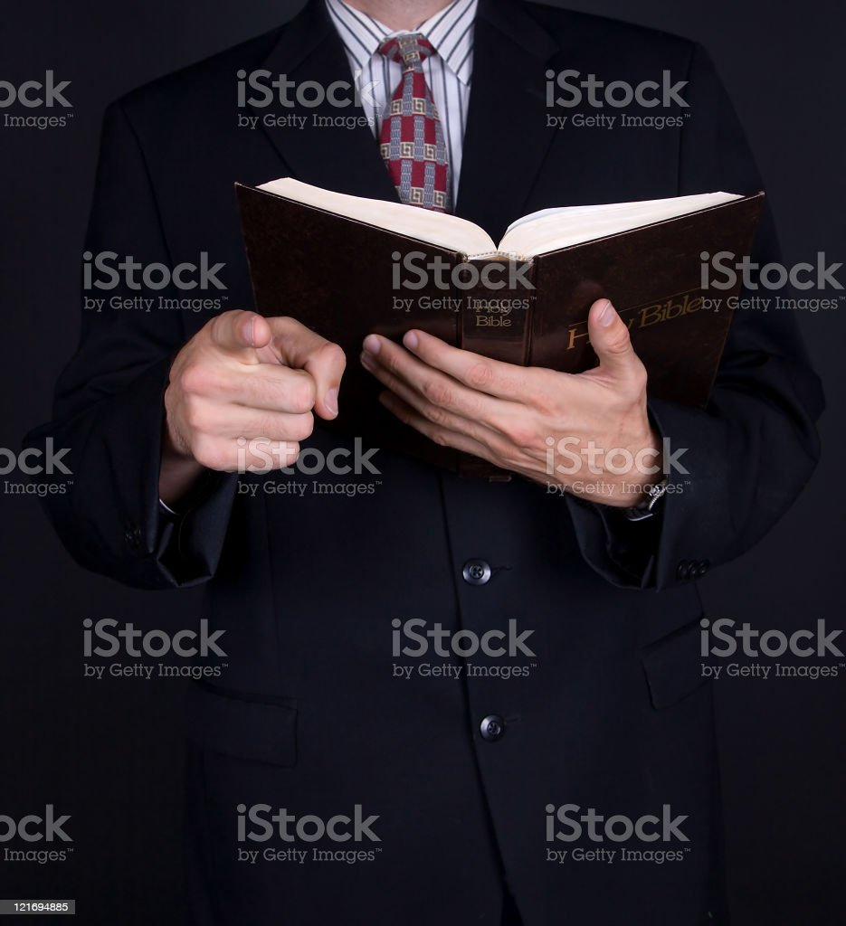 Preacher with Bible Pointing - Black royalty-free stock photo