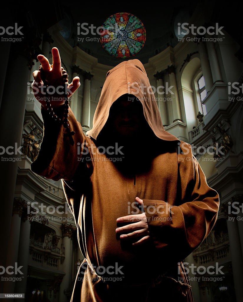 Preaching monk in church stock photo