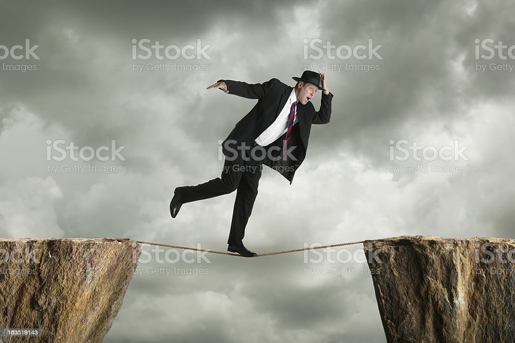 Precarious Businessman stock photo