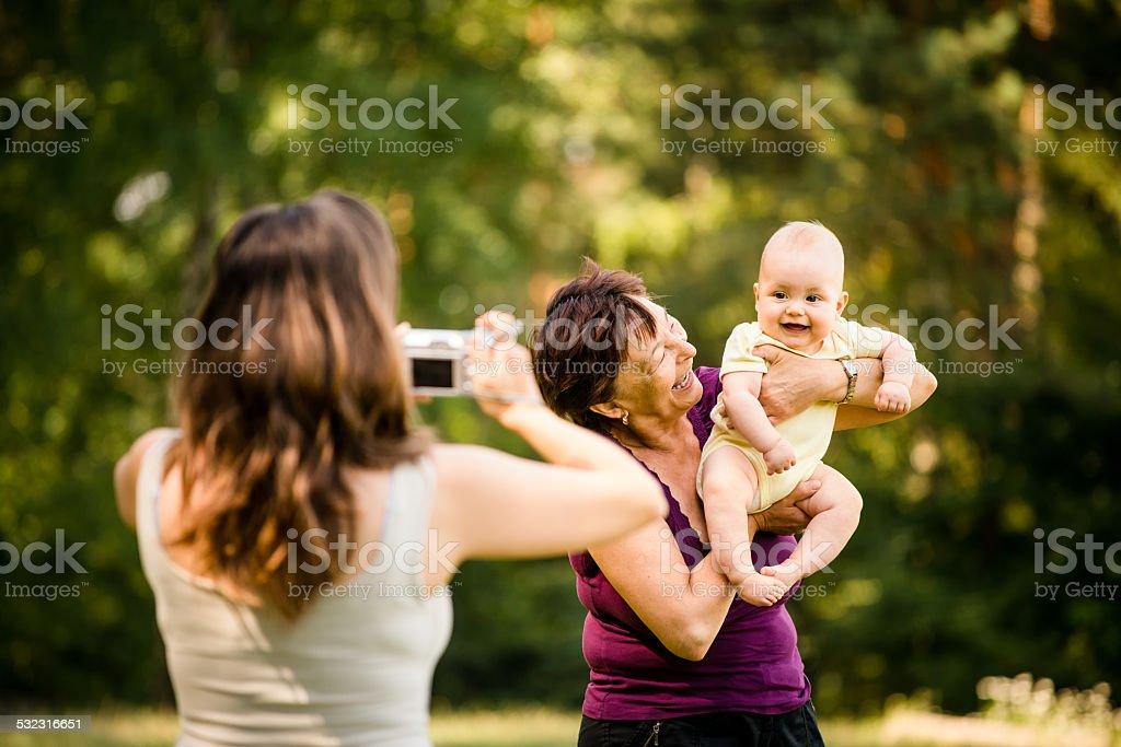 Precious memories - grandmother with baby stock photo