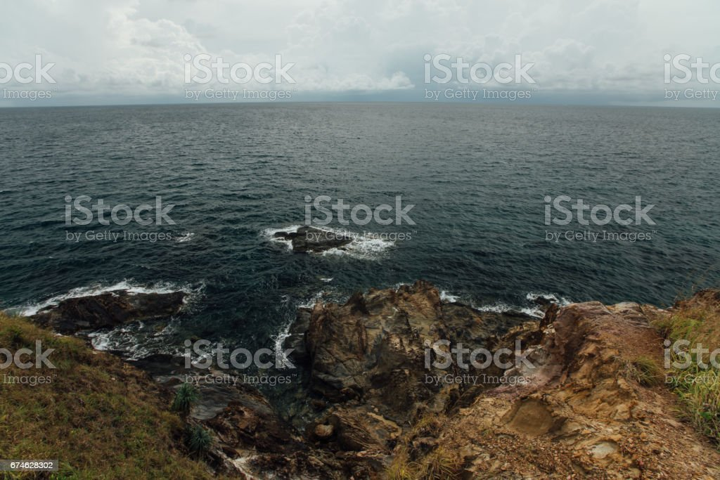 precipice is a sea view. Storm sky, power. Stones in the sea stock photo