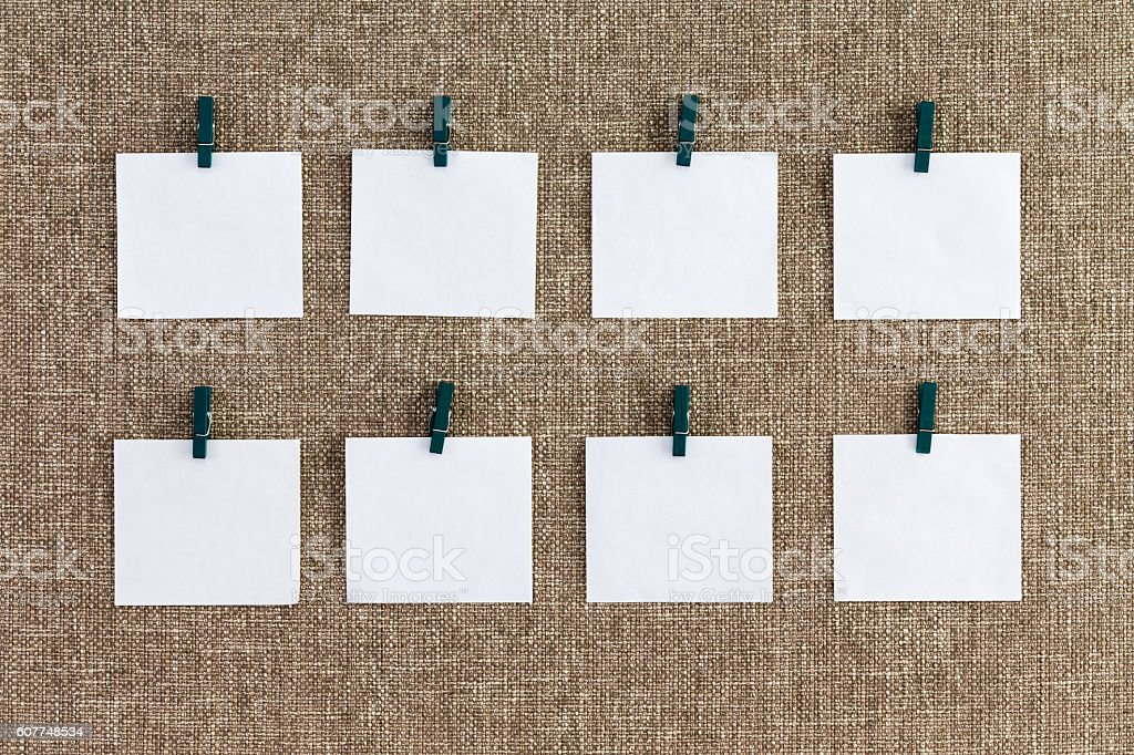 Precisely aligned rows of blank memo pads stock photo