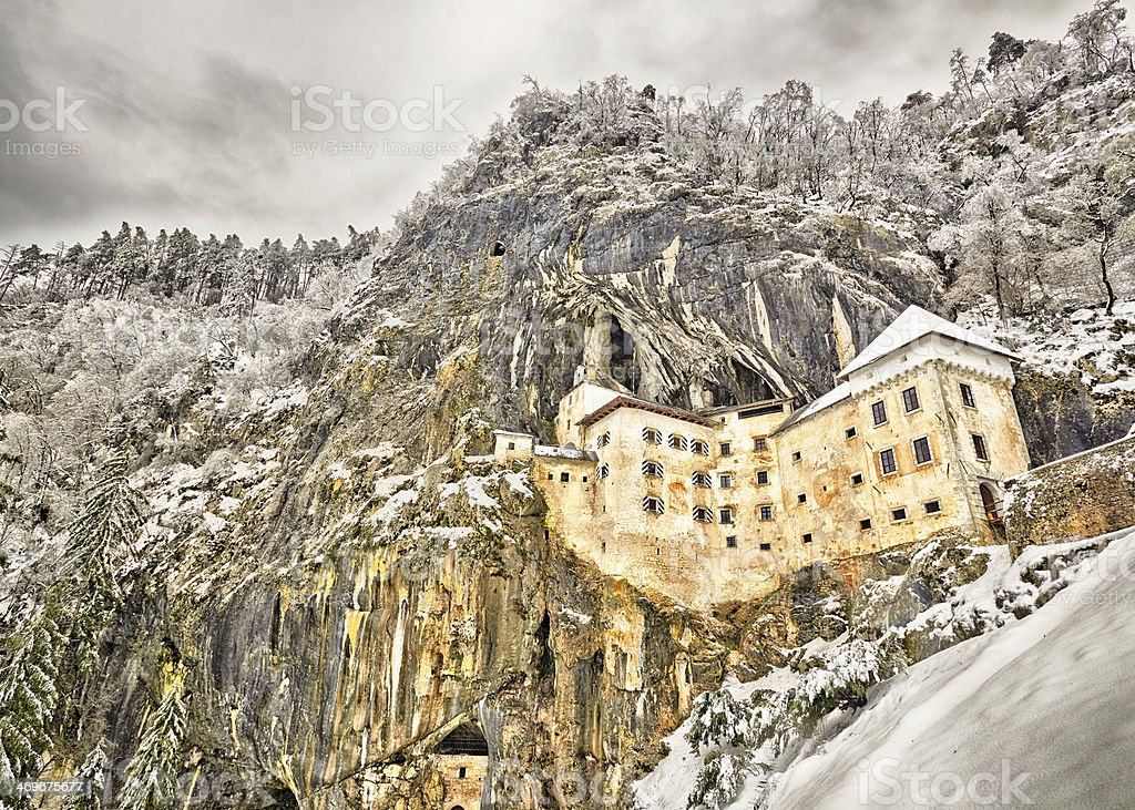 Predjamski grad in winter, Slovenia stock photo