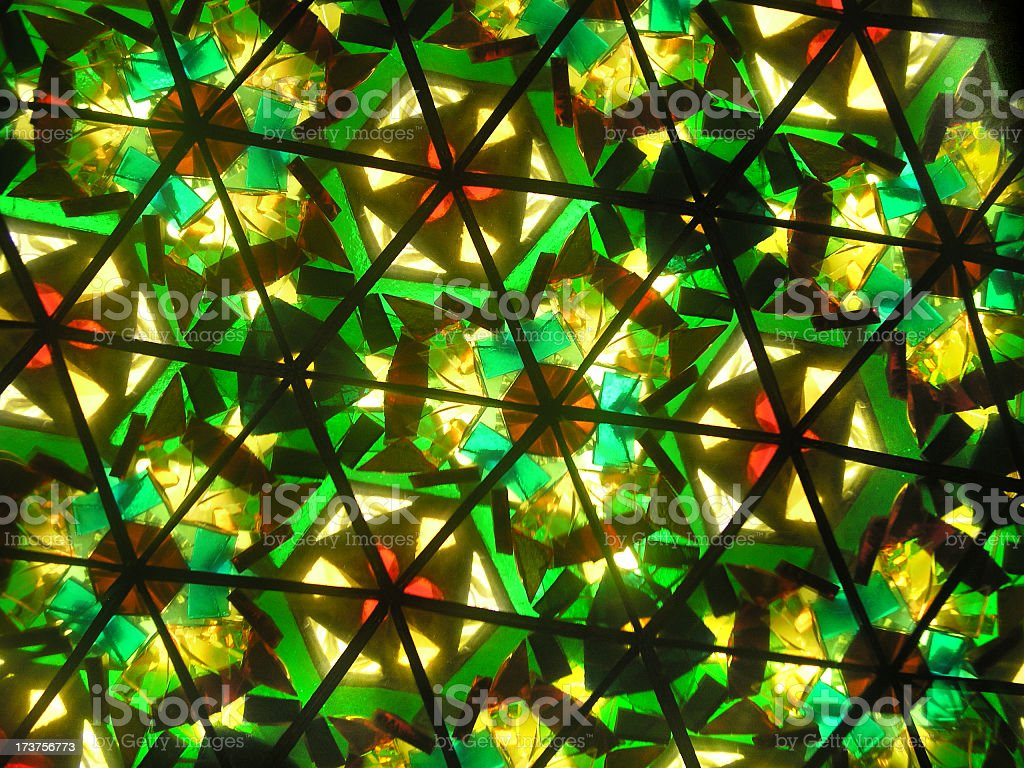 Predominantly green kaleidoscope with multiple shapes stock photo