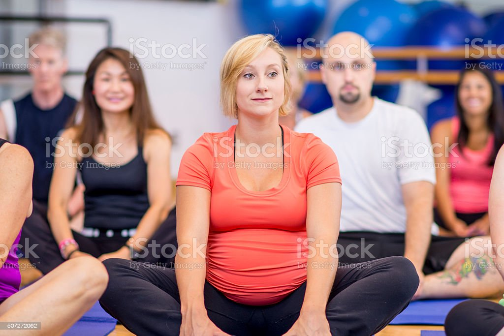 Pregant Woman Taking a Yoga Class stock photo