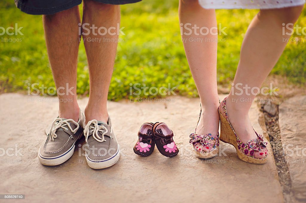 Pregnancy Announcement with Baby Shoes stock photo