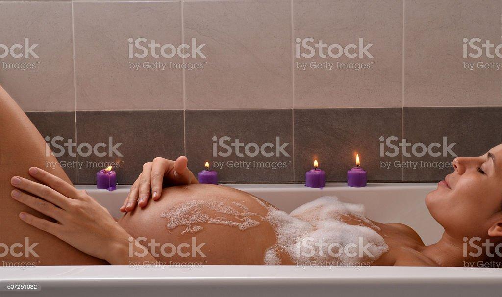 Pregnancy bath. stock photo