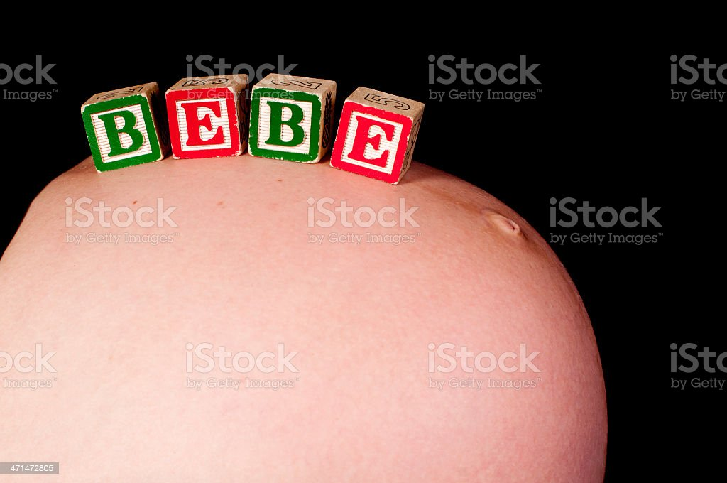 pregnancy belly with the word 'bébé' on it royalty-free stock photo