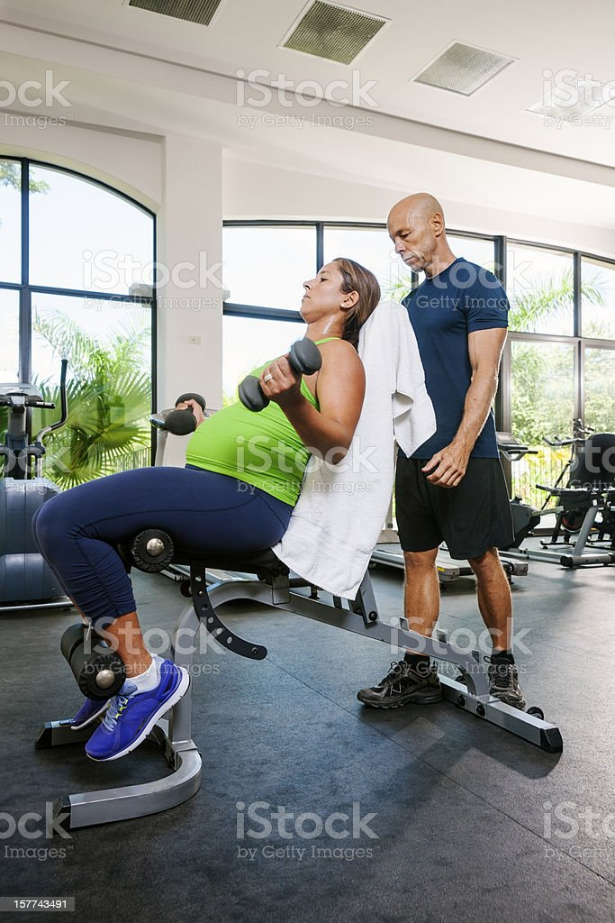 Pregnancy, fitness, trainer royalty-free stock photo