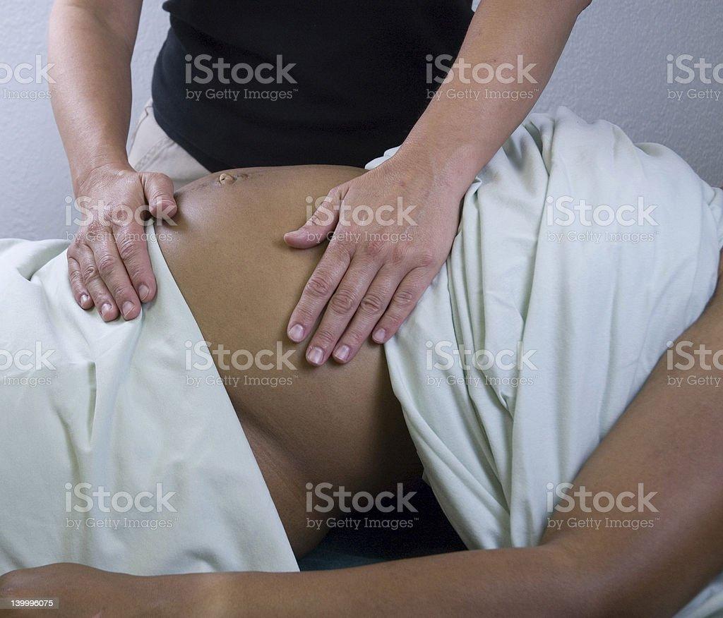 pregnancy massage royalty-free stock photo