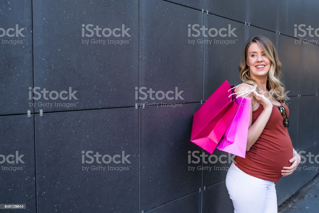 pregnancy, sale, motherhood, people and expectation concept - happy...