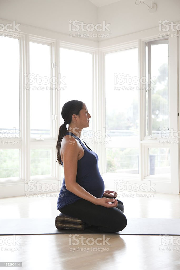 Pregnant Asian Woman Meditating stock photo