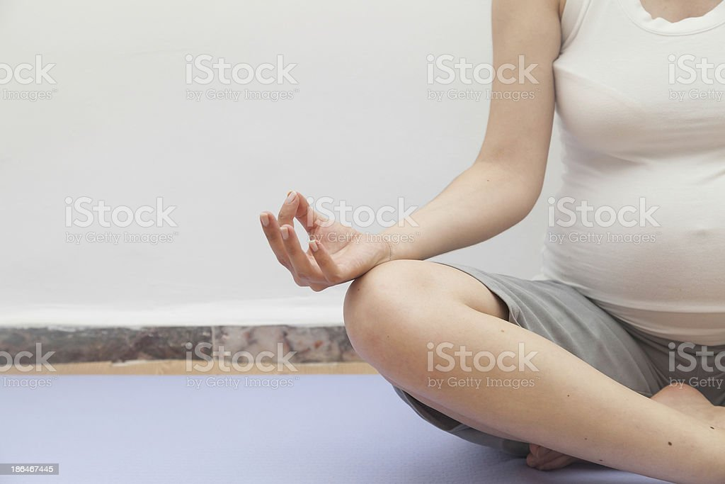 Pregnant at lotus yoga position resting stock photo